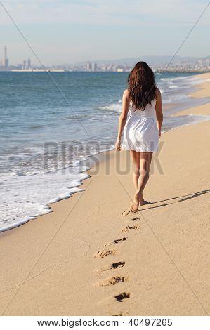 Beautiful Woman Walking On The Beach