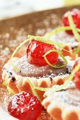 stock photo of hughes  - cupcake filled with chocolate cream and decorated with candied fruit - JPG