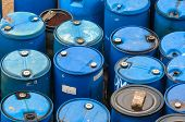 stock photo of bio-hazard  - Photo of a Chemical waste dump with a lot of barrels - JPG