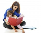 foto of babysitting  - A young hospital volunteer and preschooler reading a book together - JPG