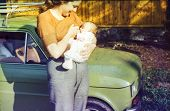 stock photo of lactation  - Vintage photo of mother breastfeeding her daughter  - JPG