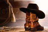 American West Rodeo Cowboy Hat On Boots And Lasso