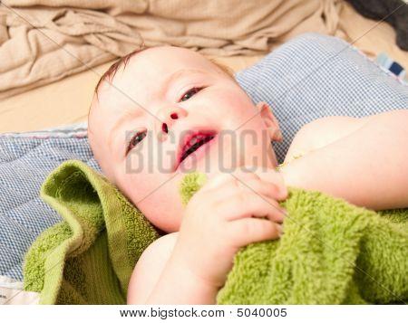 Cute Baby Boy Lying Wrapped In A Towel