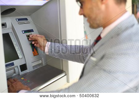 Man withdrawing money from ATM machine