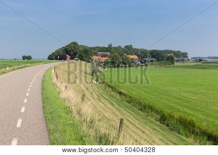 Dutch Countryside With Inland Dike And Meadows