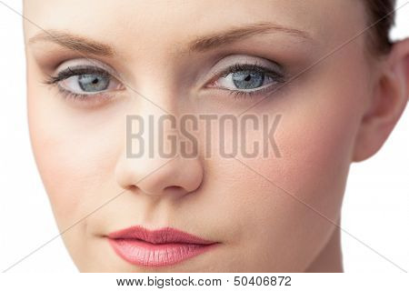 Unblemished sexy woman posing on white background