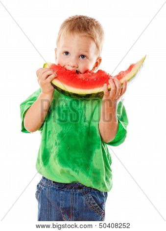 Little boy eating a watermelon