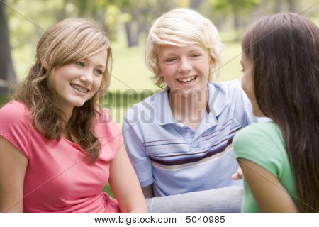 Teenagers Sitting And Conversing