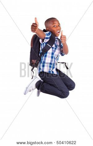African American School Boy Jumping And Making Thumbs Up - Black People