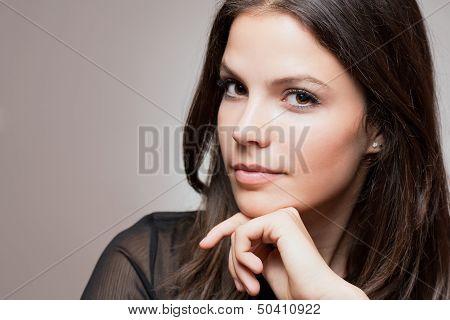 Thoughtful Brunette Beauty.