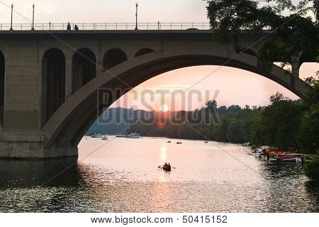 Washington DC - Key Bridge silhouette with kayaking people in Potomac River
