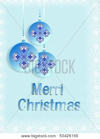 three blue Christmas balls on a light background