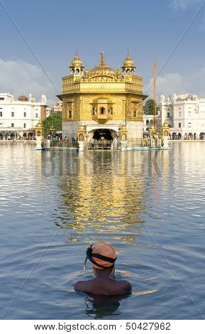 Sikh prayer in pond of Golden Temple in Amritsar, Punjab, India.