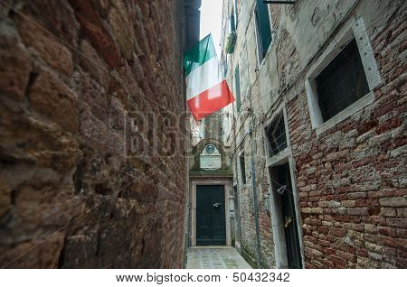 Italian National Flag In Narrow Street, Venice