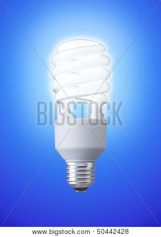 white energy saving bulb on blue background
