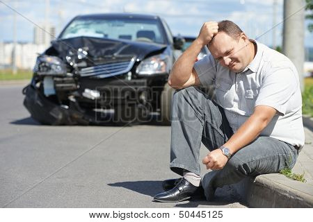 Adult upset driver man in front of automobile crash car collision accident in city road