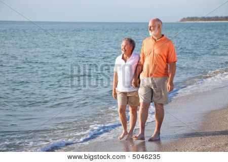 Senior Couple - Romantic Beach Stroll