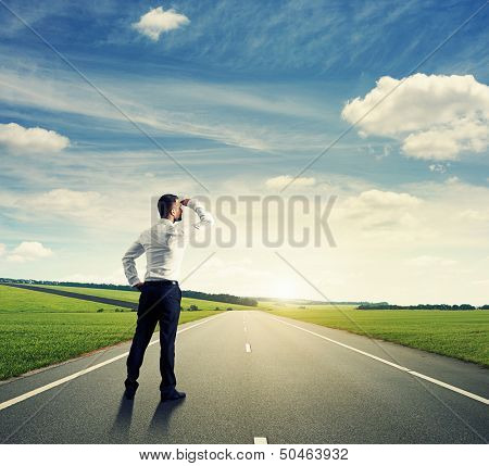 back view of businessman on road