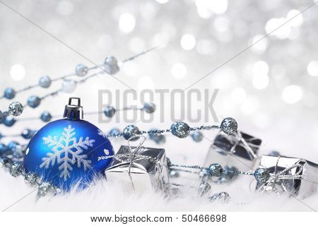 Christmas ball and giftbox on abstract background