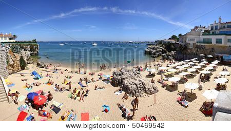 People Sunbathing On The Beach In Cascais, Portugal