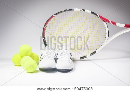 Tennis Sports Concept: Raquet, Balls And Sneakers