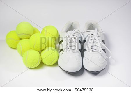 Tennis Concepts: Tennis Trainers And Tennis Balls Against White