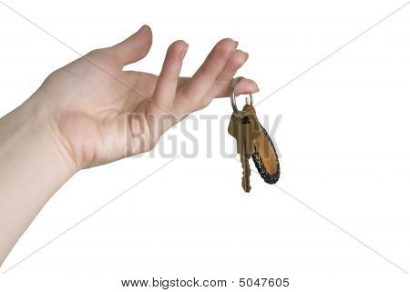 Golden Key To A Car In A Female Hand