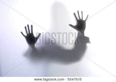 Diffused Silhouette Of A Womans Body Threw Frosted Glass