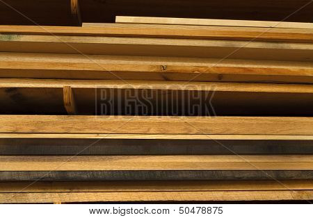 Various Boards Of Lumber Stacked In A Workshop