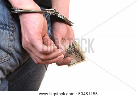 Handcuffs On Hands With Money Closeup