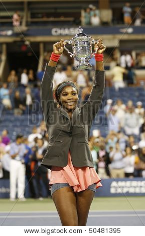 Seventeen times Grand Slam champion and US Open 2013 champion Serena Williams holding US Open trophy