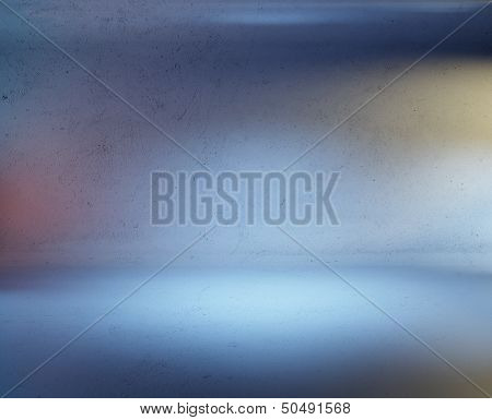 concrete wall and floor with colorful spotlights