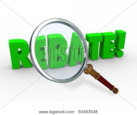 The word Rebate under a magnifying glass to illustrate finding a special money back offer by shopping as a bargain hunter