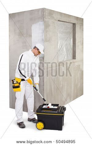 Worker With A Painter Roller Brush