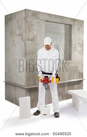 Worker Mixing An Insulation Adhesive