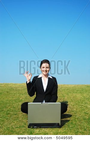 Businesswoman Outdoors Making 'okay' Gesture