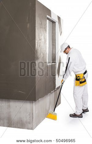 Worker Cleaning With A Broomstick