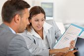 pic of presenter  - Young woman presenting business plan to financial investor - JPG