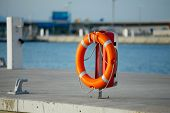picture of coast guard  - Lifebuoy in a dock - JPG