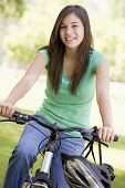 stock photo of 13 year old  - Teenage Girl On Bicycle - JPG