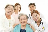 foto of polite  - Smiling Asian medical staff with old women - JPG