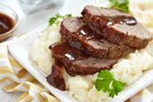 stock photo of meatloaf  - Meatloaf with brown sauce on mashed potato - JPG