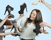 Woman Surrounded By Many Shoes