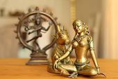picture of gad  - Goddess Parvati contemplates and her husband is dancing - JPG