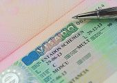 Schengen Multi Visa In Passport With Pen Above