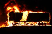pic of horrific  - Large Cargo Truck on fire burning. Horrific car crash at night due to speeding on the motorway drink driving. The truck disintegrating because of the enormous heat. Terrible Loss. ** Note: Slight blurriness, best at smaller sizes - JPG