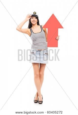 Young, beautiful and sexy sailor girl with a red arrow isolated on white background