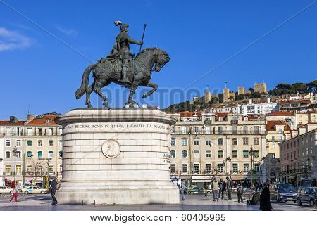 Lisbon, Portugal - February 02, 2013: Figueira Square in the Baixa (Downtown) district. King Dom Joao I statue and Sao Jorge Castle on top of hill