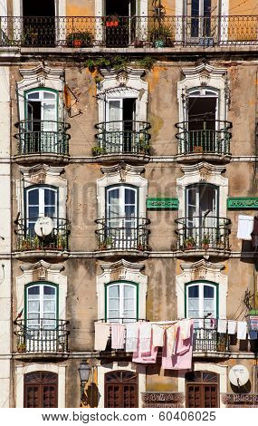 Lisbon, Portugal - February 01, 2013: Old and damaged 18th century neoclassical building in lower Alfama district. Typical Pombaline style.