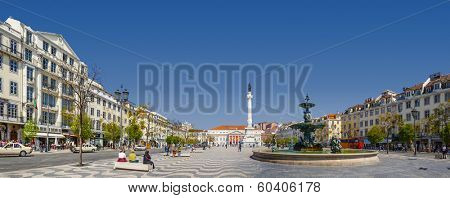 Lisbon, Portugal - April 14, 2013: Rossio (Dom Pedro IV) Square with Dom Pedro IV monument, Dona Maria II National Theatre in background and fountain
